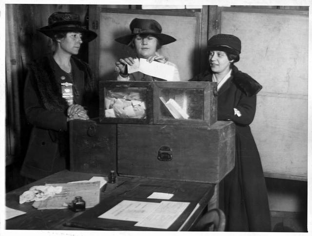 [Three suffragists casting votes in New York City(?)]