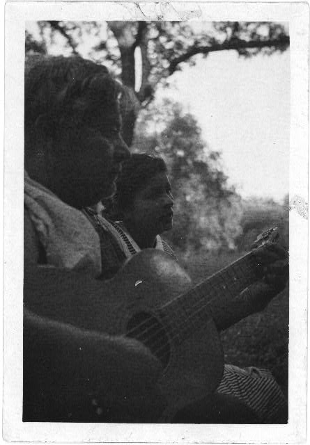 [Pedro Zuniga playing the guitar with his daughter Zenovia, San Antonio, Texas]