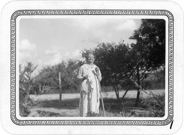 Mrs. Elizabeth Fulks in her garden at Stanton, Texas