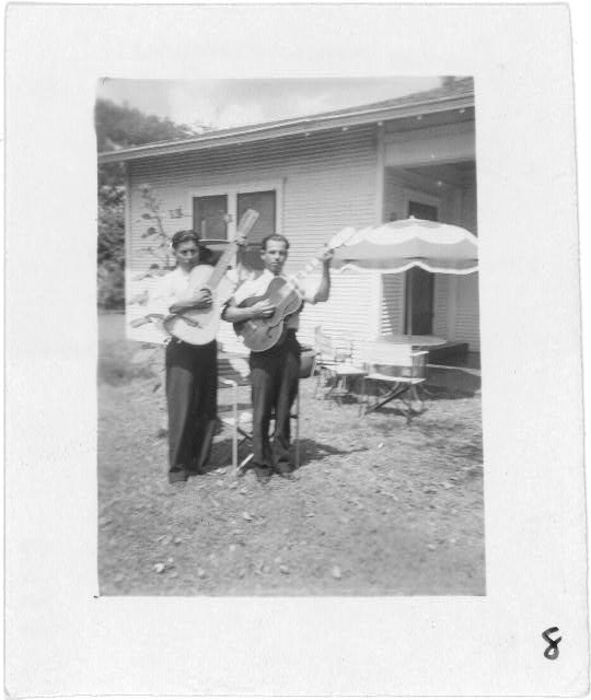 [Lolo Mendoza and Chico Real, with guitars, at the home of Mrs. Sarah Kleberg Shelton, Kingsville, Texas]