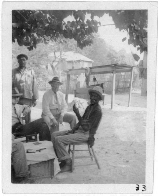 [Uncle Billy McCrea (right), with John A. Lomax (center), and friends, at Billy's home in Jasper, Texas]