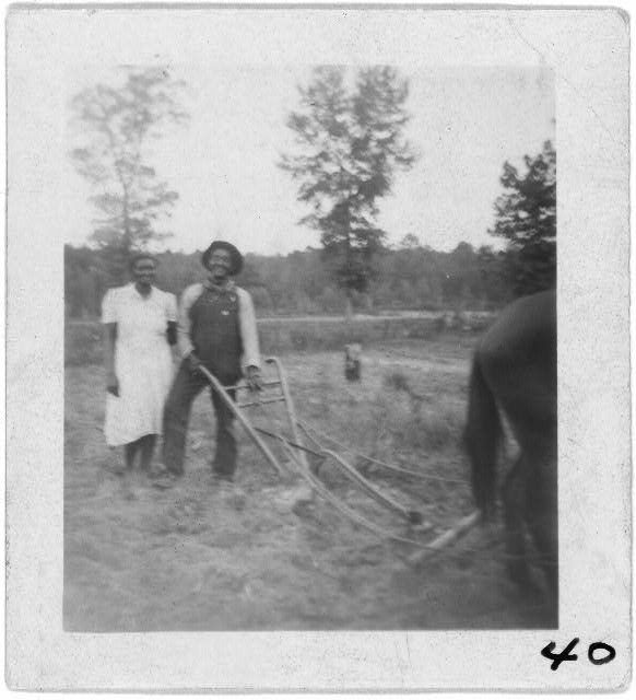 [Henry Truvillion and wife, in the garden, near Newton, Texas]
