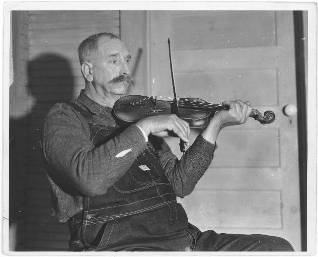 [Crockett Ward (with fiddle)]