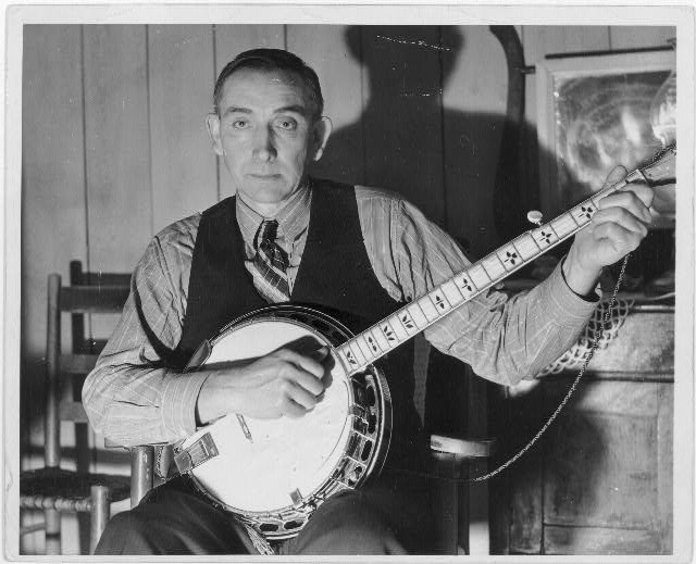 [Wade Ward of Bog Trotters Band, with banjo, Galax, Virginia]