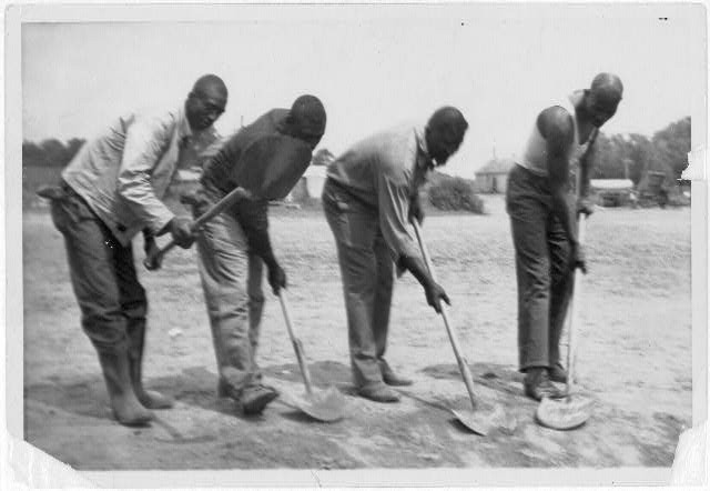 [African American convicts working with shovels, possibly at Darrington State Farm, Texas, 1934, or Cummins State Farm, Gould, Arkansas, 1934]