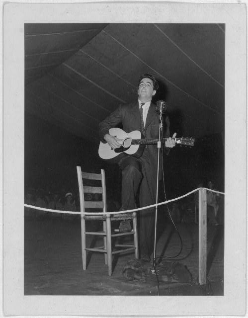 [Alan Lomax playing guitar on stage at the Mountain Music Festival, Asheville, N.C.]