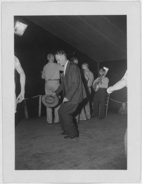 [Fiddling Bill Hensley, dancing in foreground at the Mountain Music Festival, Asheville, North Carolina]