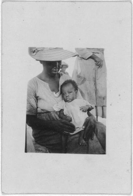 [Woman with infant, Old Bight, Cat Island, Bahamas, July 1935]
