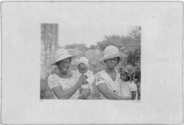 [Two women with children, Old Bight, Cat Island, Bahamas, July 1935]