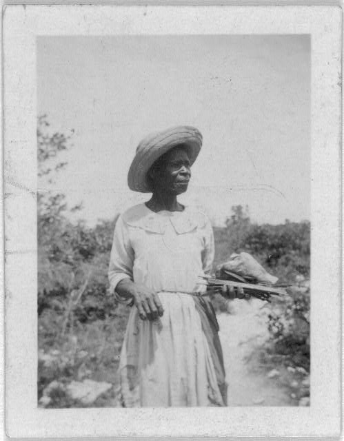 [Woman standing, facing right, possibly from the visit by Alan Lomax and Mary Elizabeth Barnicle to Andros Island in the Bahamas]