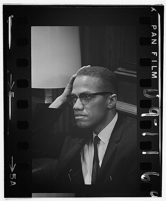 [Malcolm X waits at Martin Luther King press conference, head-and-shoulders portrait]