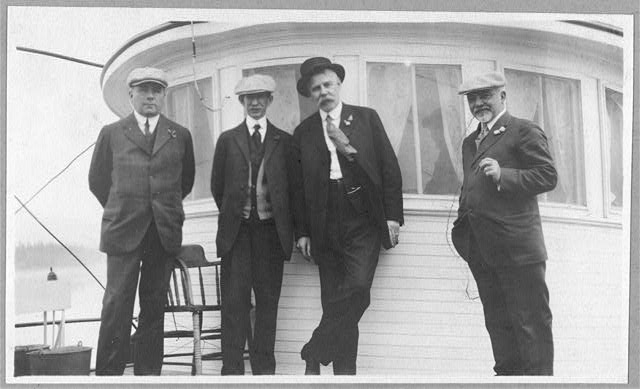 W.H. Fairbanks, Frank G. Carpenter, Tom Magowan, and Mr. MacPherson