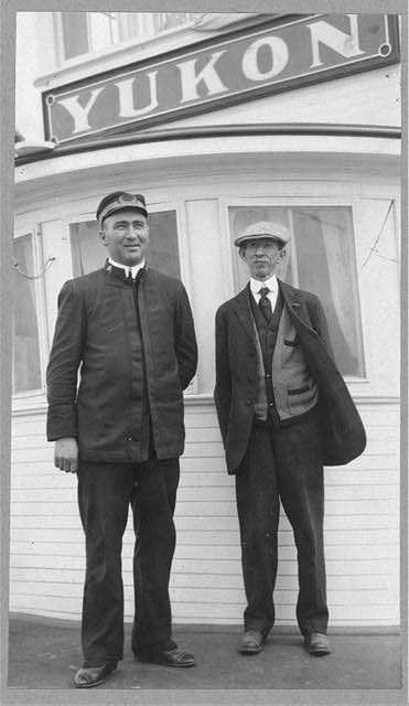 Frank G. Carpenter at right