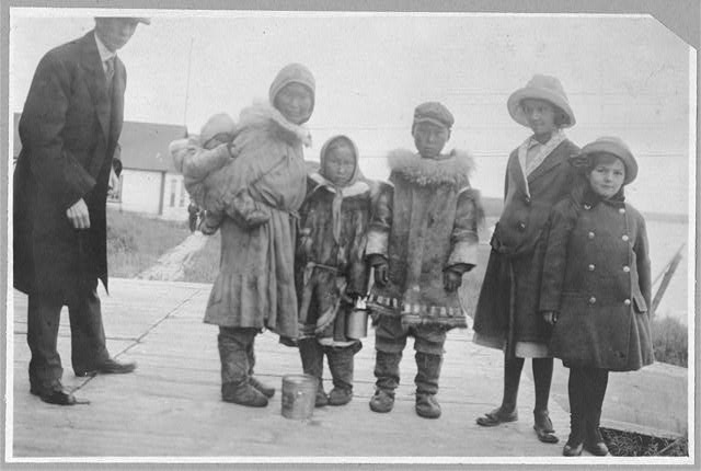 Frank G. Carpenter and Margaret White with Eskimos