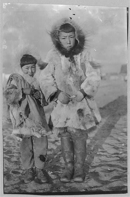 [Two Eskimo boys on a windy day]