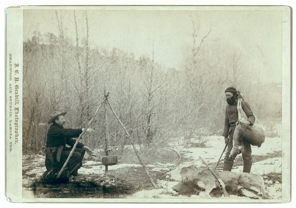 """Hunting Deer."" A deer hunt near Deadwood in winter 1887 and 1888. Two miners McMillan and Hubbard got their game."