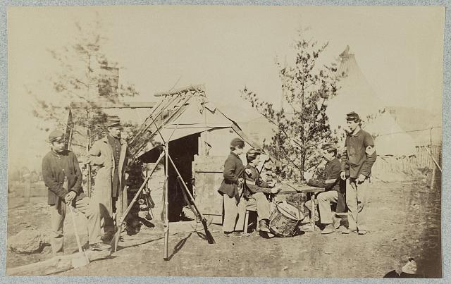 [Drummer boys off duty, playing cards in camp, winter of 1862]