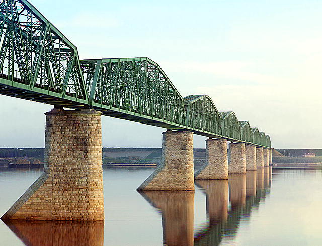 [Trans-Siberian Railway metal truss bridge on stone piers, over the Kama River near Perm, Ural Mountains Region]