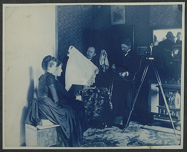 [Two unidentified women being photographed]