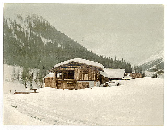 [Winter scene with log structure, Grisons, Switzerland]