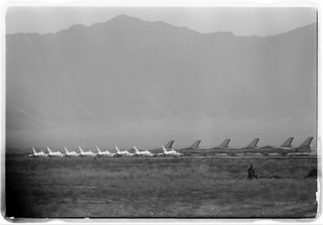 [Rows of airplanes on an air field surrounded by grasslands and mountains in Kabul, Afghanistan, during President Eisenhower's visit]