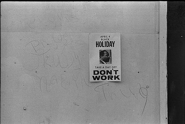 "[""Don't work"" sign promoting a holiday to honor the anniversary of the assassination of Martin Luther King, Jr., on a shop on H Street, N.W., Washington, D.C.]"