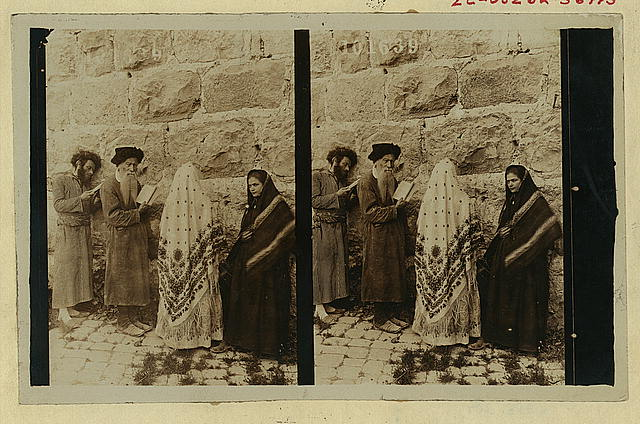 [Two Jewish men and two women standing in front of  the Wailing Wall, Jerusalem]