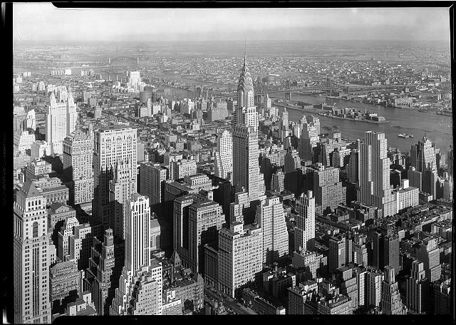 Empire State Building, New York City. [View from], to Chrysler Bldg. and Queensboro Bridge, low viewpoint