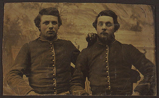 [Ruben Farwell (right) and an unidentified man, half-length studio portrait, facing front, wearing military uniforms]