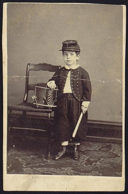 [P.H. Martin, full-length studio portrait, standing, facing front, wearing uniform, with drum]