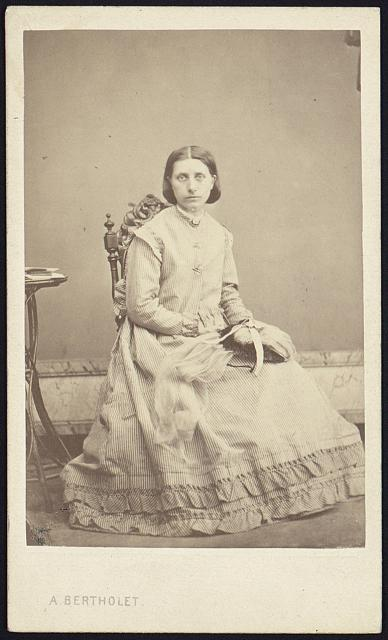 [Antoinette Margot, full-length studio portrait, seated, facing front]