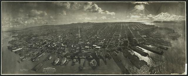 Photograph of San Francisco in ruins from Lawrence Captive Airship, 2000 feet above San Francisco Bay overlooking water front. Sunset over Golden [Gat]e