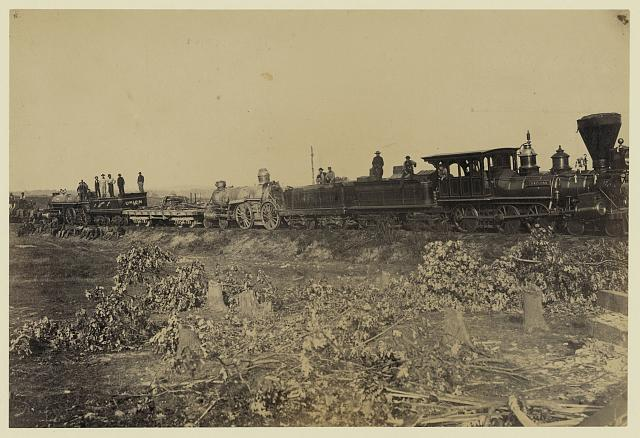 Remains of wreck on the track, ready for transportation to Alexandria.  This train was thrown from the track by the Rebels