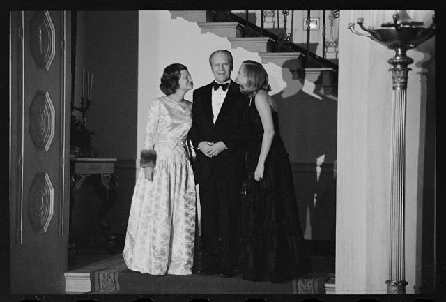 [President Gerald Ford, First Lady Betty Ford, and daughter Susan Ford at a White House Christmas party, Washington, D.C.]