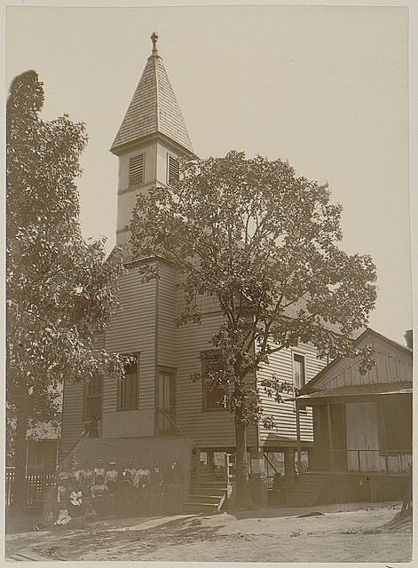 [African American men and women standing outside church in Georgia]