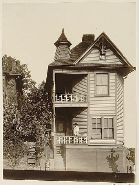 [African American man standing on porch of house in Georgia]