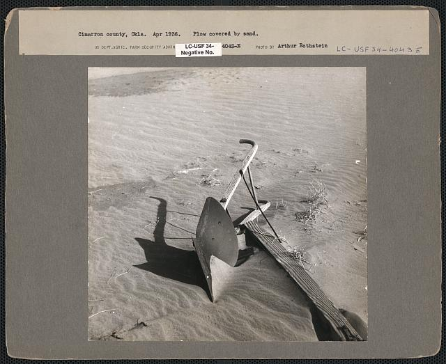Plow covered by sand. Cimarron County, Oklahoma