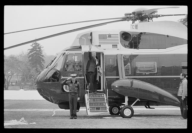[President Jimmy Carter waves goodbye as he departs the White House, Washington, D.C., for Camp David, Maryland aboard Marine One]