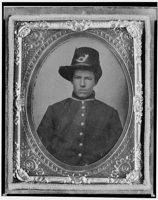 [Harrison (Harry) Corbin, Pvt., U.S.A., half-length portrait facing front]