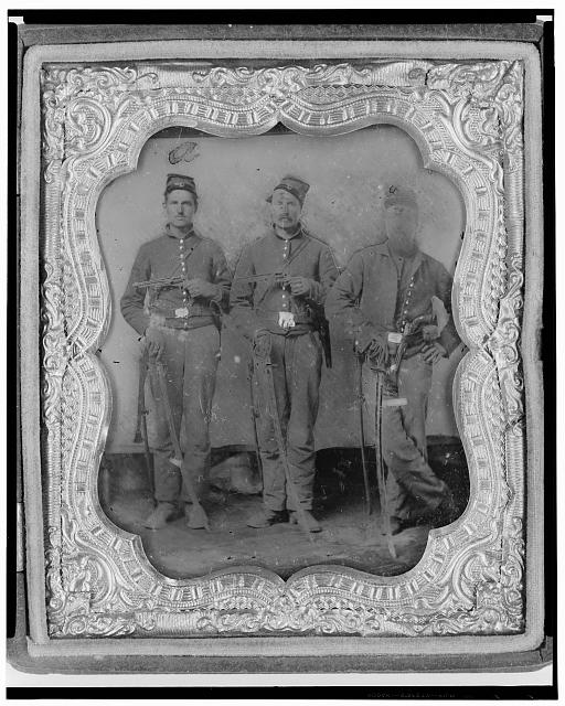 [Pvt. Frank A. Remington and two other Union soldiers, full-length portrait, facing front]