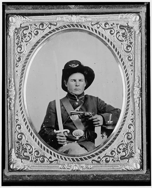 [George Kimbrue, Pvt., 93rd Indiana Infantry, U.S.A., half-length portrait, seated holding a pistol and a saber]