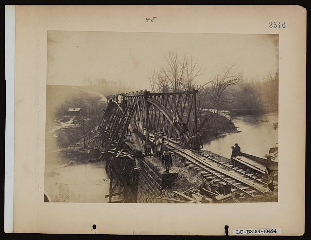 Part of construction corps building new military truss bridge across Bull Run, April 1863