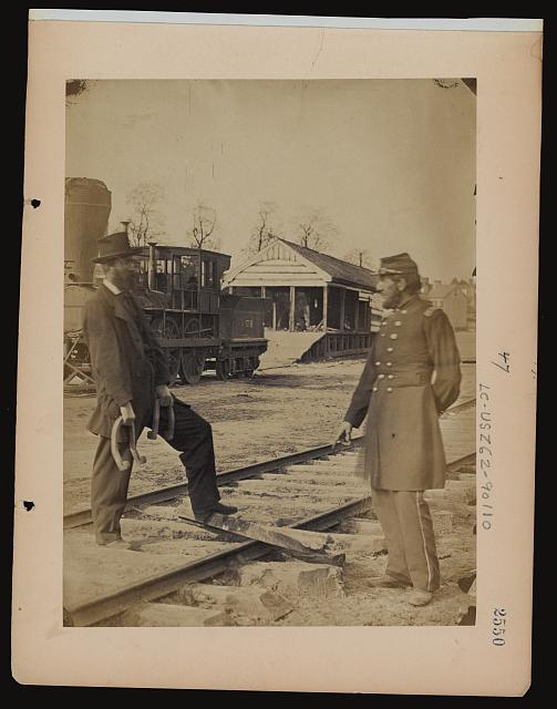 [Military railroad operations in northern Virginia: soldier and another man standing at railroad tracks in front of locomotive]
