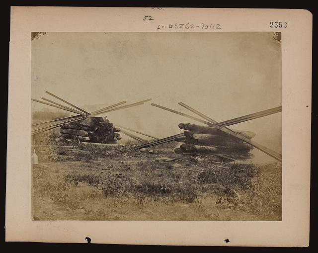 [Military railroad operations in northern Virginia: two piles of rails and wooden ties]