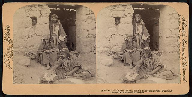 A woman of modern Jericho, baking unleavened bread, Palestine