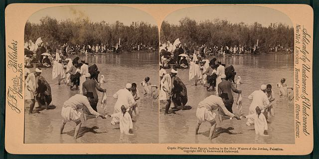 Coptic pilgrims from Egypt, bathing in the Holy Waters of the Jordan, Palestine