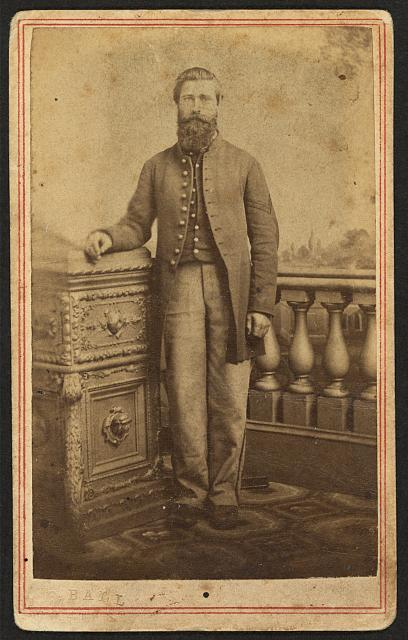 [Full-length portrait of a soldier, identified in inscription as Pvt. C. Kelsey, Company C, 152nd New York Volunteers]