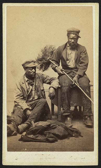 [Occupational portrait of two African American chimney sweeps]