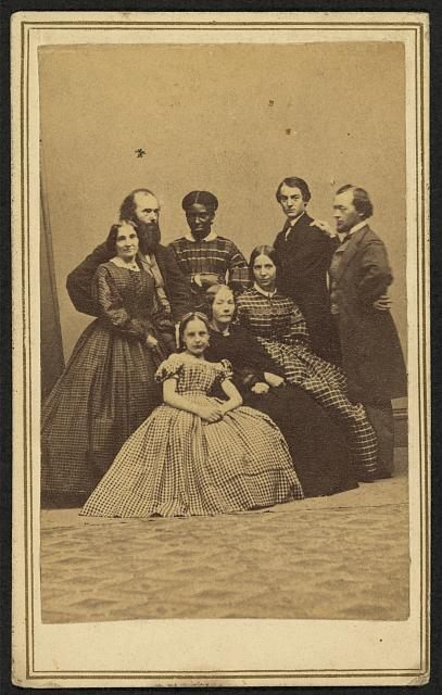 [Group portrait, possibly a family, with an African American woman]