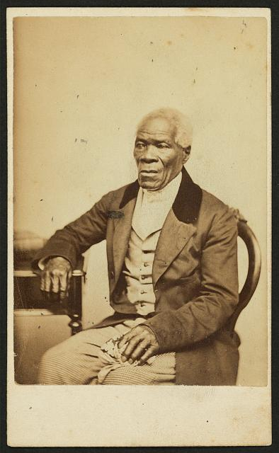 [Three-quarter-length portrait of an unidentified elderly African American man seated]